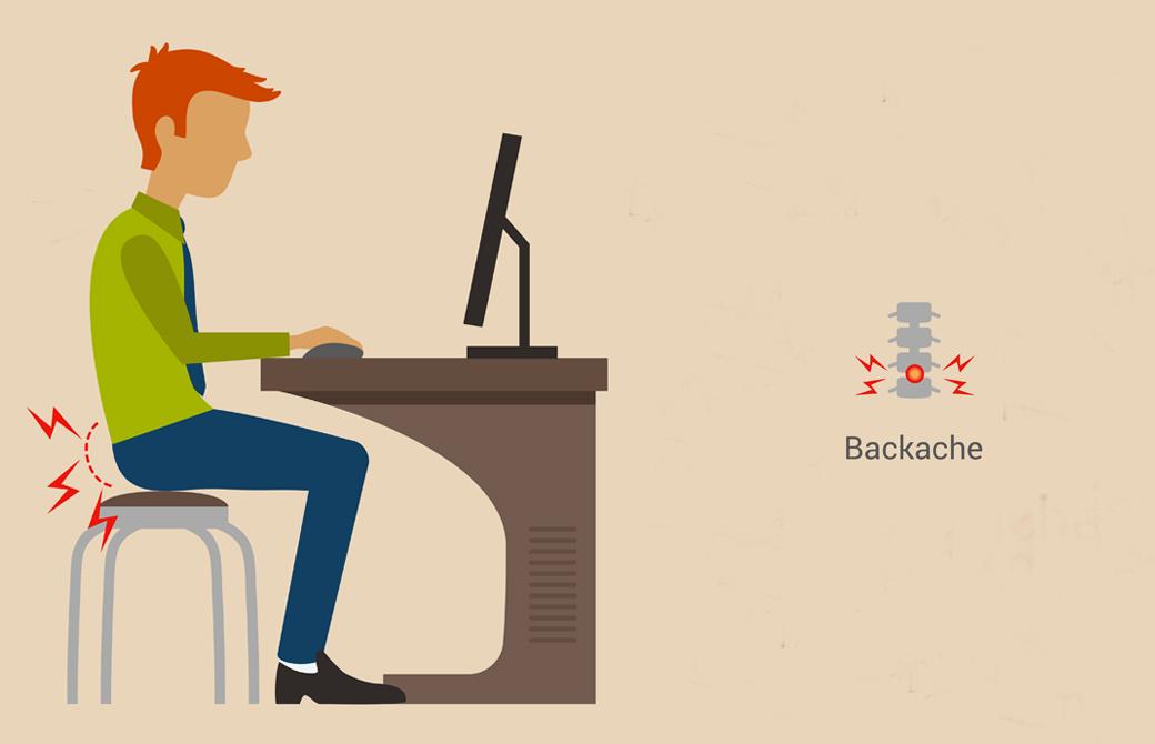 パソコンに向かって座っている腰が痛い男性イラスト。